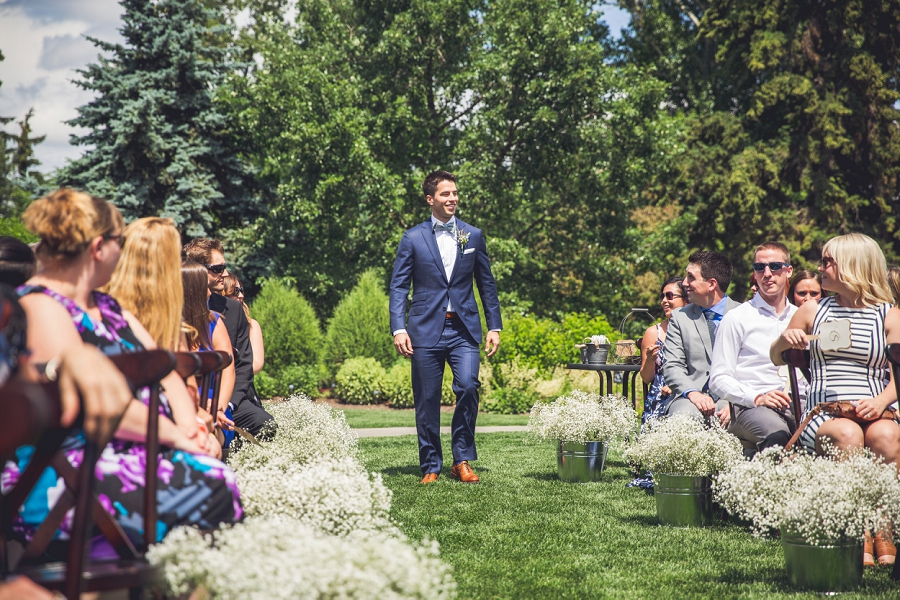 calgary zoo wedding summer groom walking down aisle