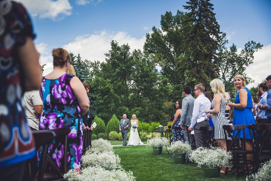 bride walking down aisle with father calgary zoo wedding summer