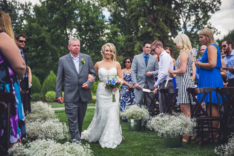 bride with father walking down aisle calgary zoo wedding summer