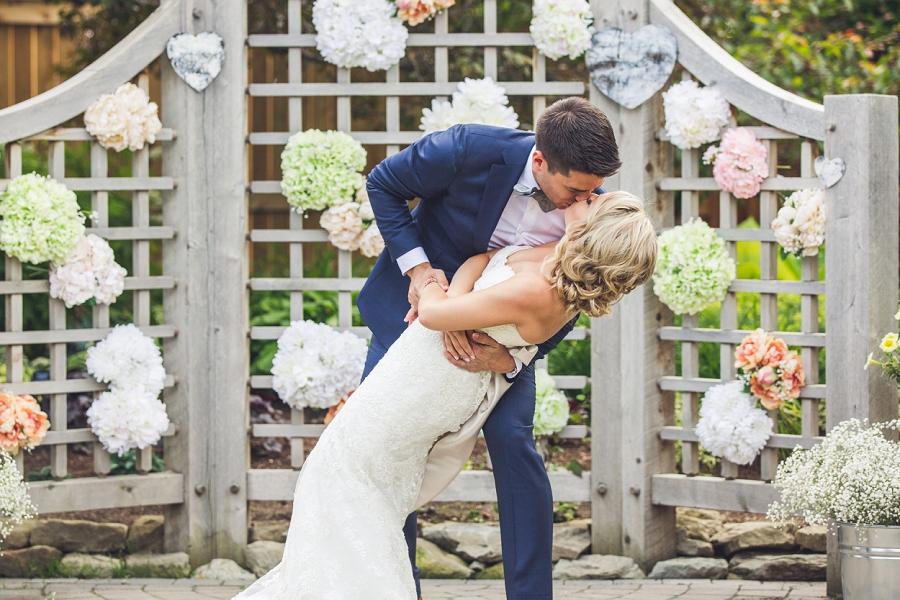 bride groom first kiss dip calgary zoo wedding summer