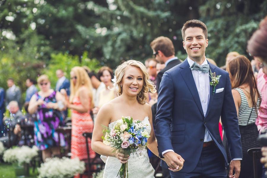 bride groom leaving calgary zoo wedding summer