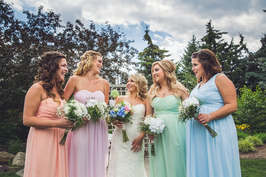bride with bridesmaids laughing calgary zoo wedding summer