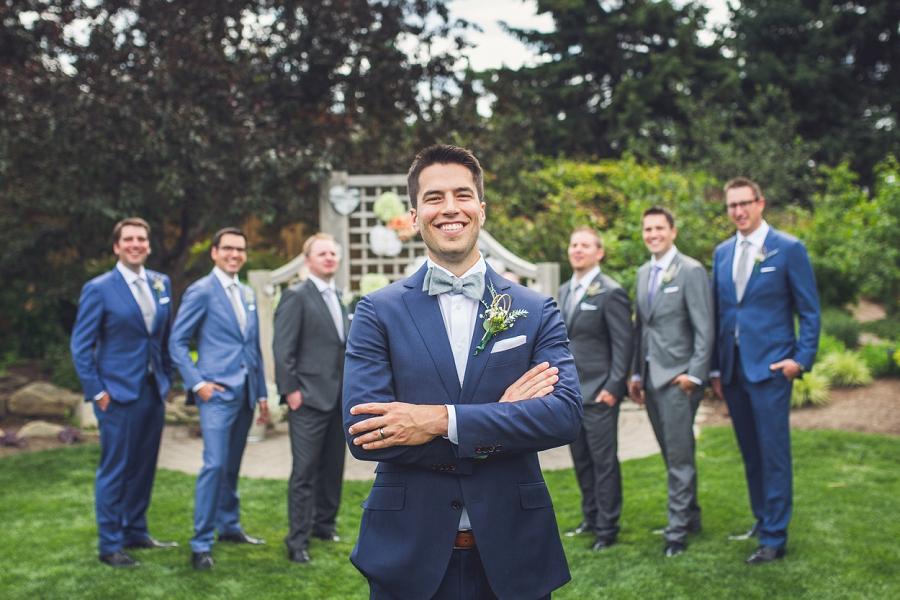 groom with groomsmen calgary zoo wedding summer