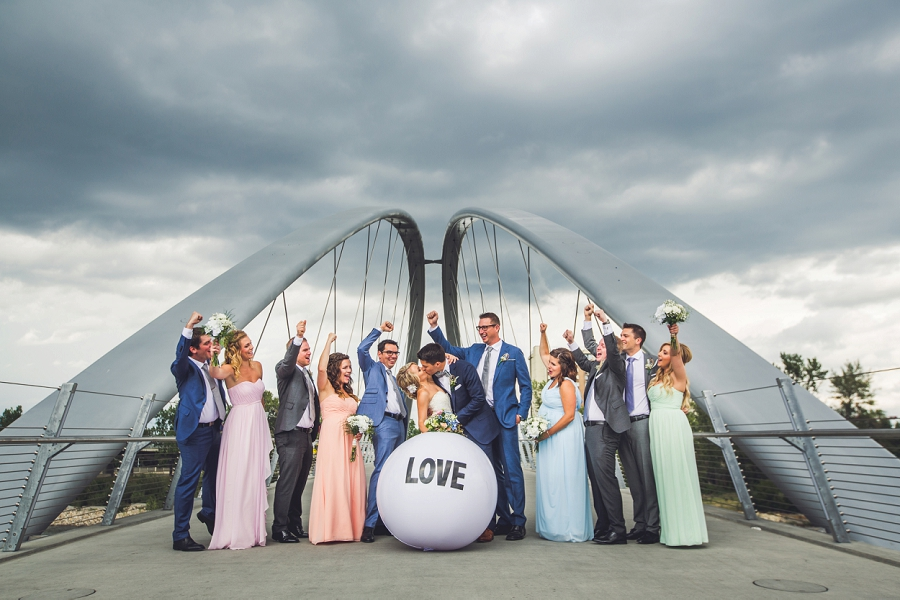 bridal party on bridge with love ball calgary wedding photographer
