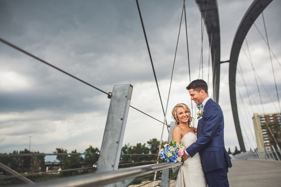 calgary wedding photographer bride groom on bridge