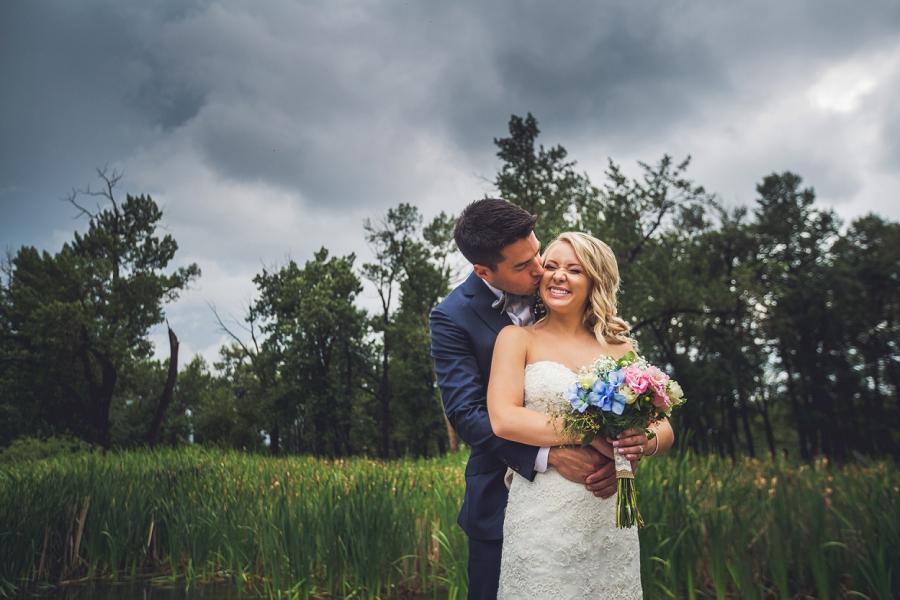 calgary wedding photographer bride groom kiss