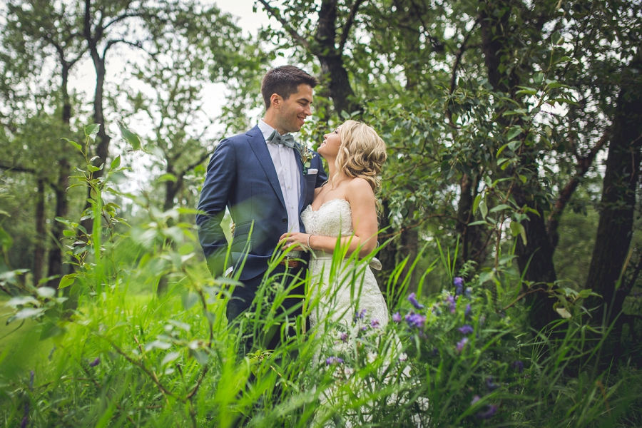 bride groom in the tall grass calgary wedding photographer