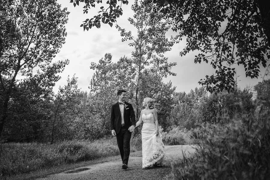 bride groom walking black and white calgary wedding photographer