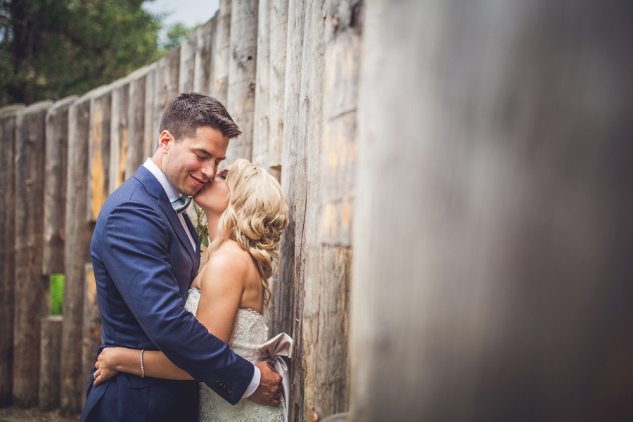 bride kisses groom calgary wedding photographer