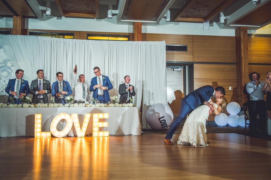 calgary zoo summer wedding bride groom first dance dip kiss
