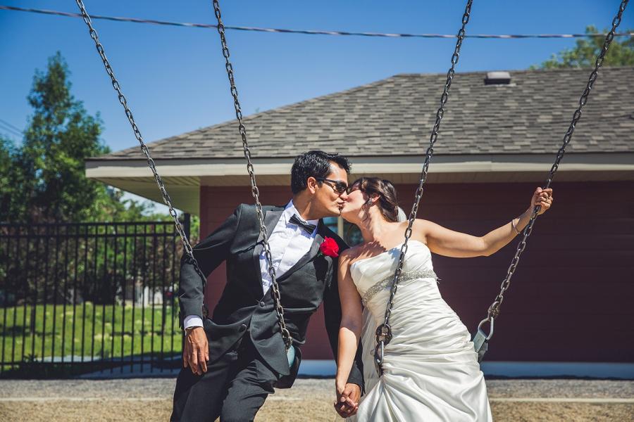 bride groom on swings calgary international wedding