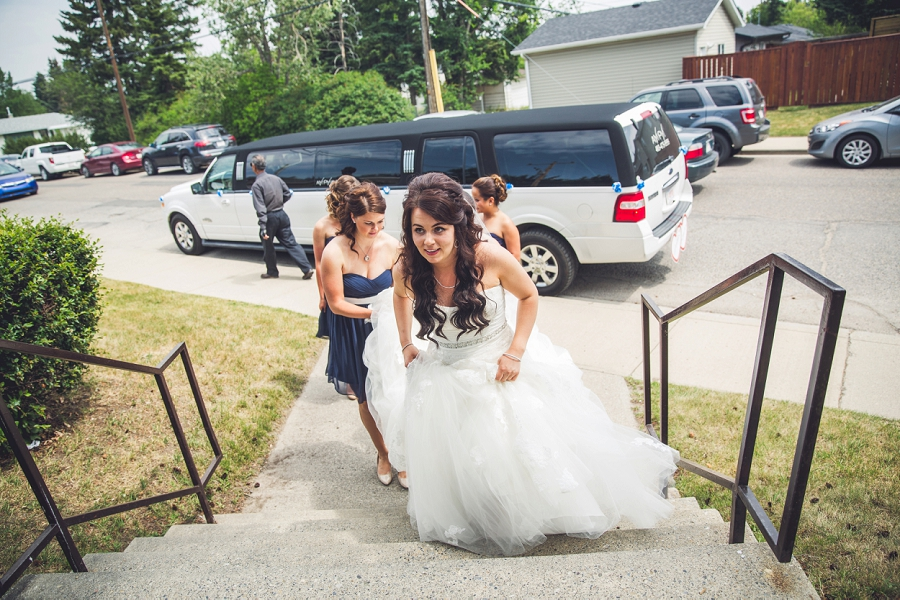 bride arriving to church st. pius x church calgary wedding