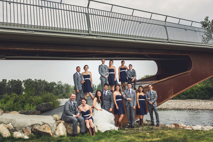 bridal party under bridge calgary wedding photographer