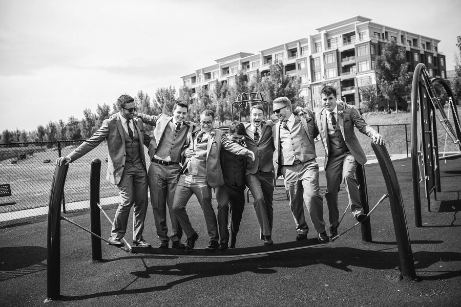 groomsmen on playground calgary summer wedding photographer