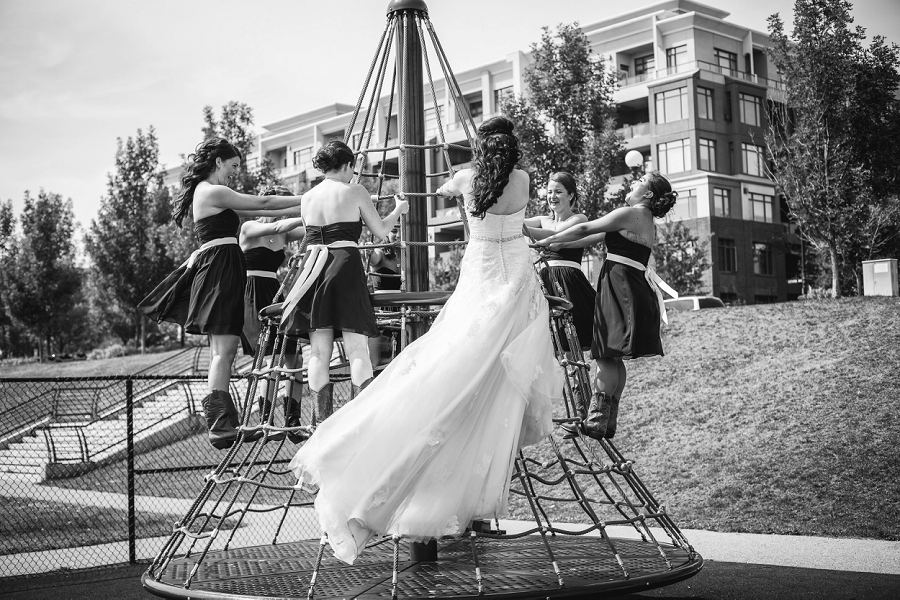 bride with bridesmaids playground calgary wedding photographer