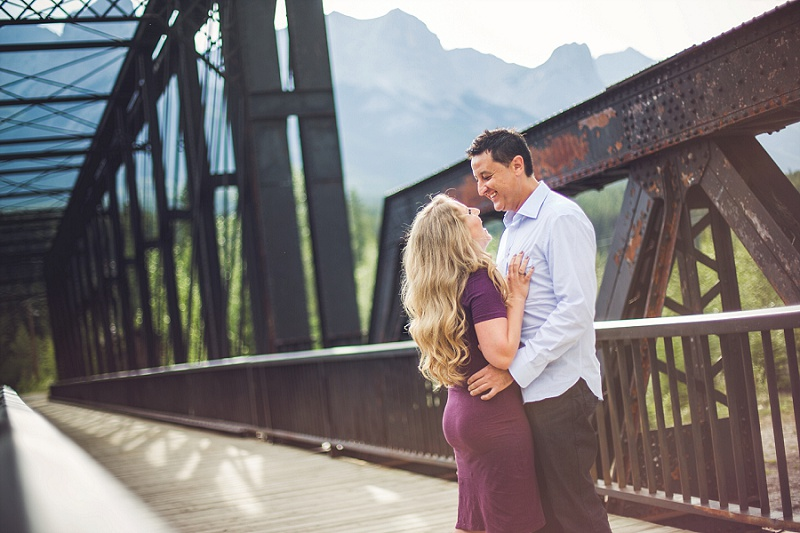 couple laughing engine bridge canmore quarry lake engagement session