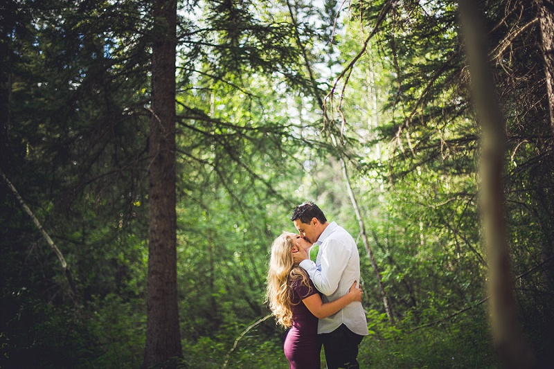 canmore engagement session forest couple kissing