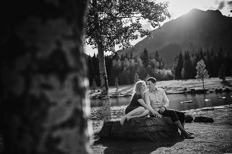 canmore quarry lake engagement session sitting on rock