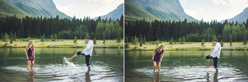 couple splashing each other canmore quarry lake engagement session