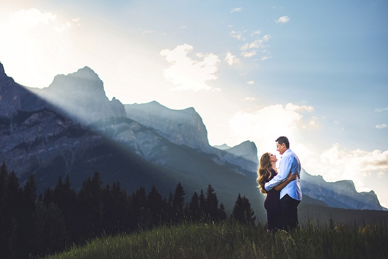 sun setting over mountains canmore quarry lake engagement session
