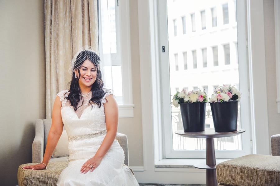 fairmont palliser calgary wedding bride sitting with bouquet hotel room