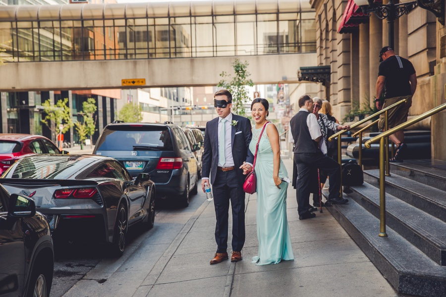 fairmont palliser calgary wedding groom blindfolded teal bridesmaid dress