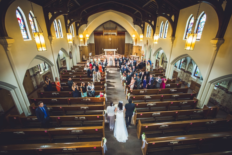 bride walking down aisle sacred heart church calgary wedding