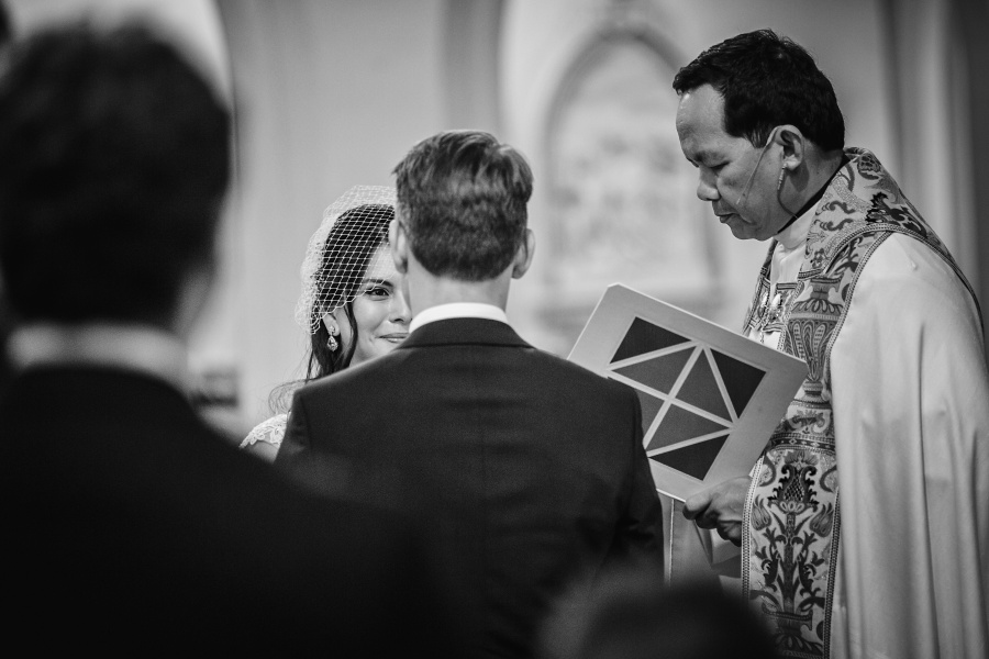 bride looking at groom sacred heart church calgary wedding photography