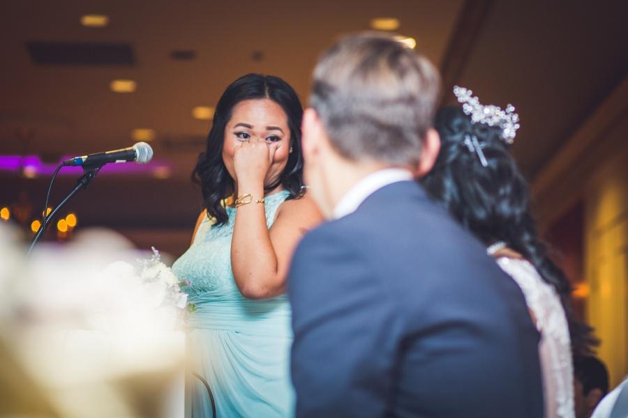 fairmont palliser calgary wedding reception bridesmaid tearing up teal dress