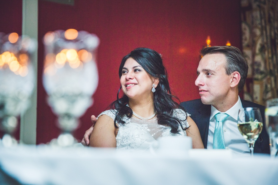 bride groom red wall fairmont palliser calgary wedding reception