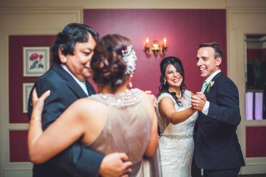 fairmont palliser calgary wedding reception bride groom first dance with parents