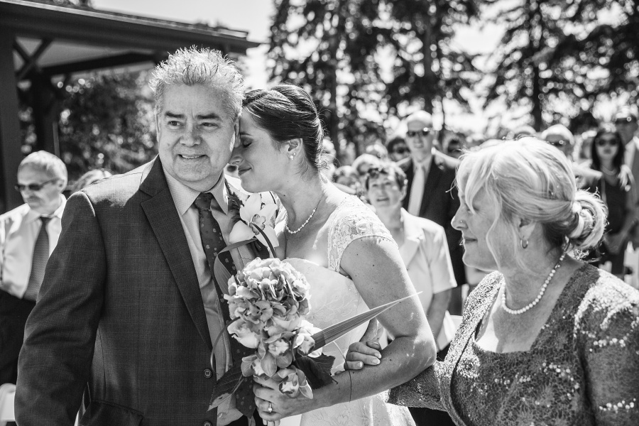 Bow Valley Ranche Restaurant Calgary Wedding bride hugging dad
