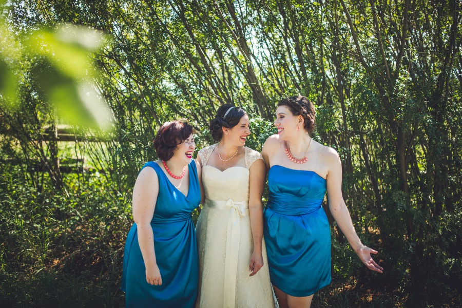 Bow Valley Ranche Restaurant Calgary Wedding bride bridesmaids laughing