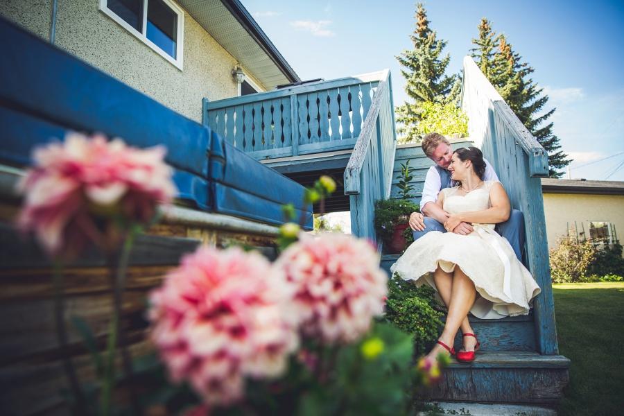 bride groom at home calgary wedding photography dahlia flowers