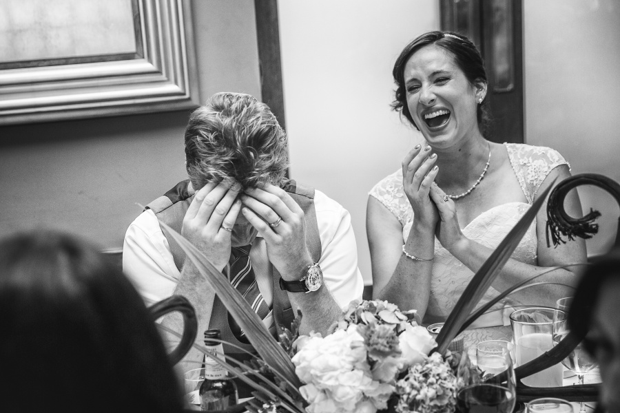 Teatro Restaurant Calgary Wedding bride groom laughing during speeches