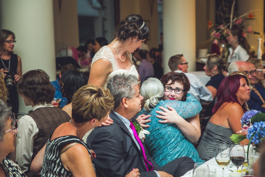 bridesmaid hugging brides mom Teatro Restaurant Calgary Wedding