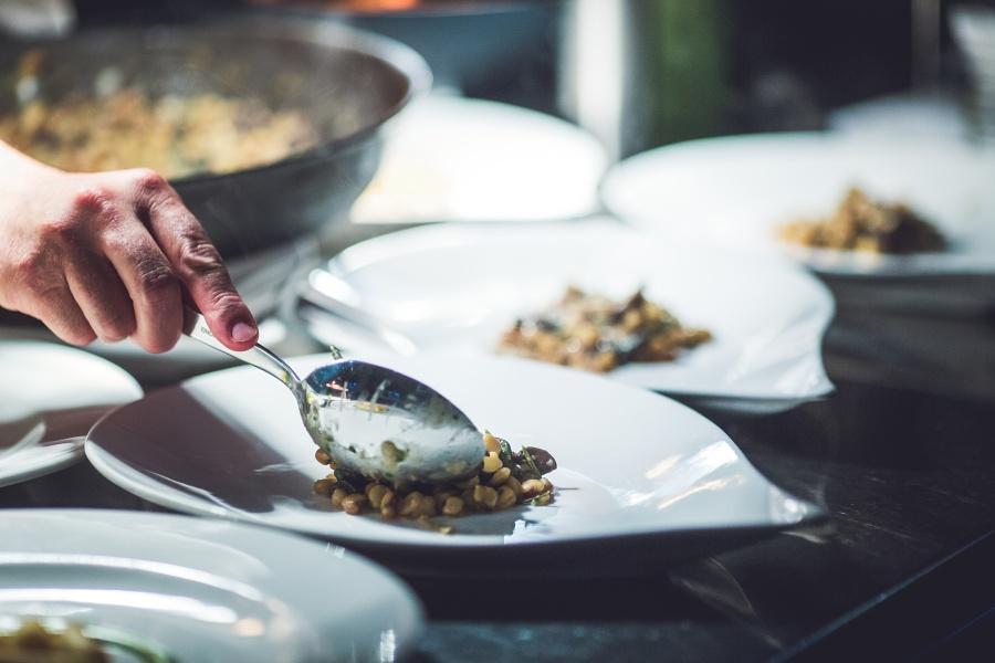 chef serving meal Teatro Restaurant Calgary Wedding