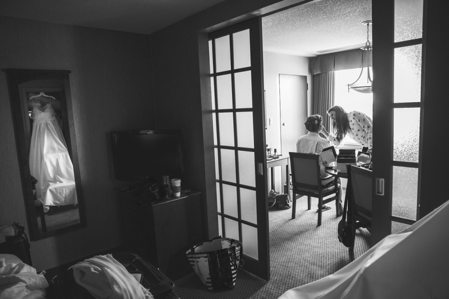 carriage house inn calgary wedding photographer bride with wedding dress getting ready