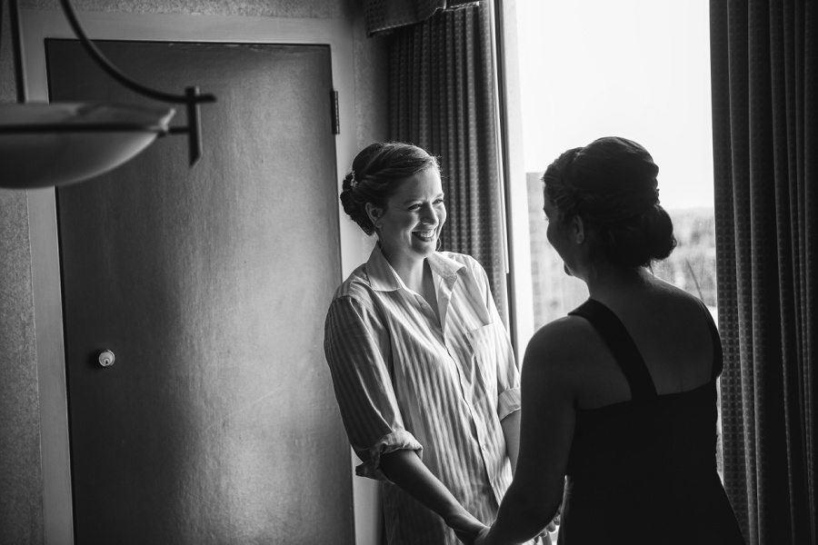 carriage house inn calgary wedding photographer bride smiling with maid of honor