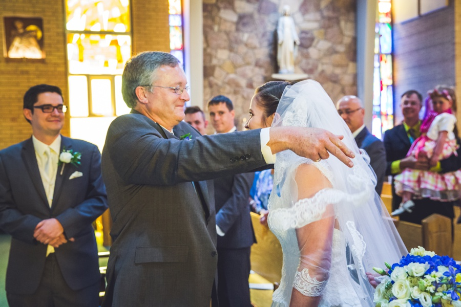 st anthony's parish calgary latin wedding photographer bride's dad unveils bride