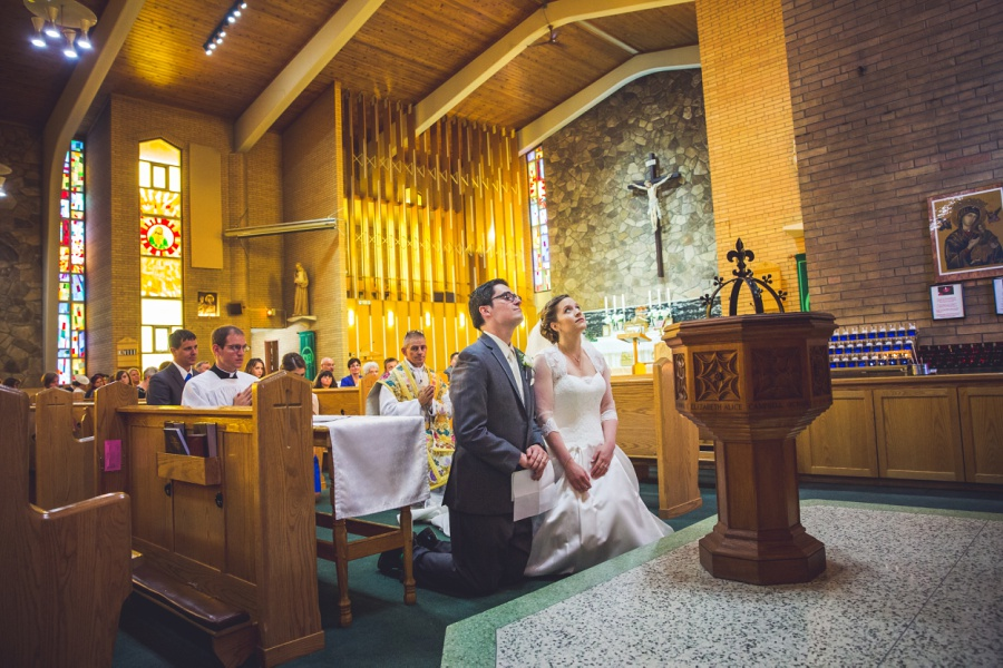 st anthony's parish calgary latin wedding photographer bride groom in prayer