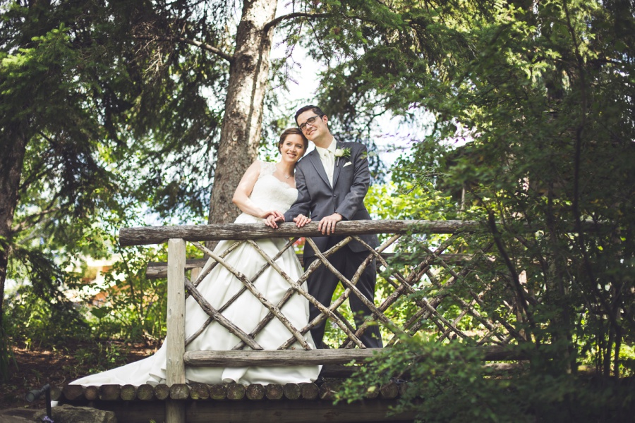 calgary latin wedding photographer bride groom on wooden bridge