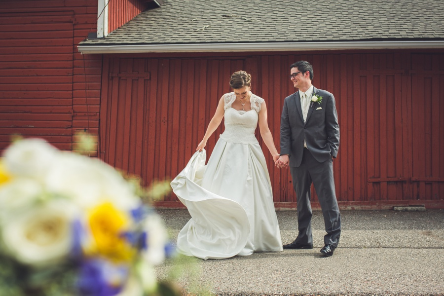 calgary latin wedding photographer bride and groom with red barn
