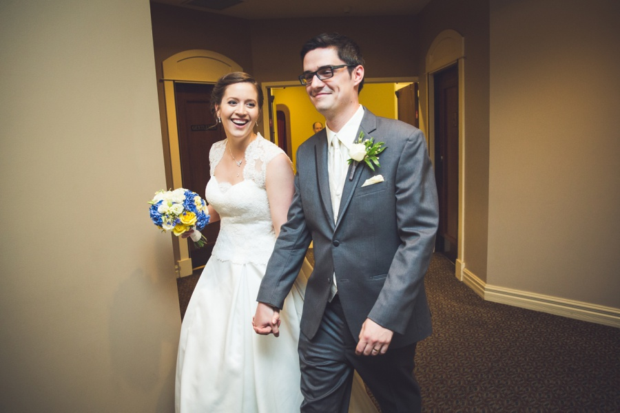calgary latin wedding photographer carriage house inn bride groom enter room