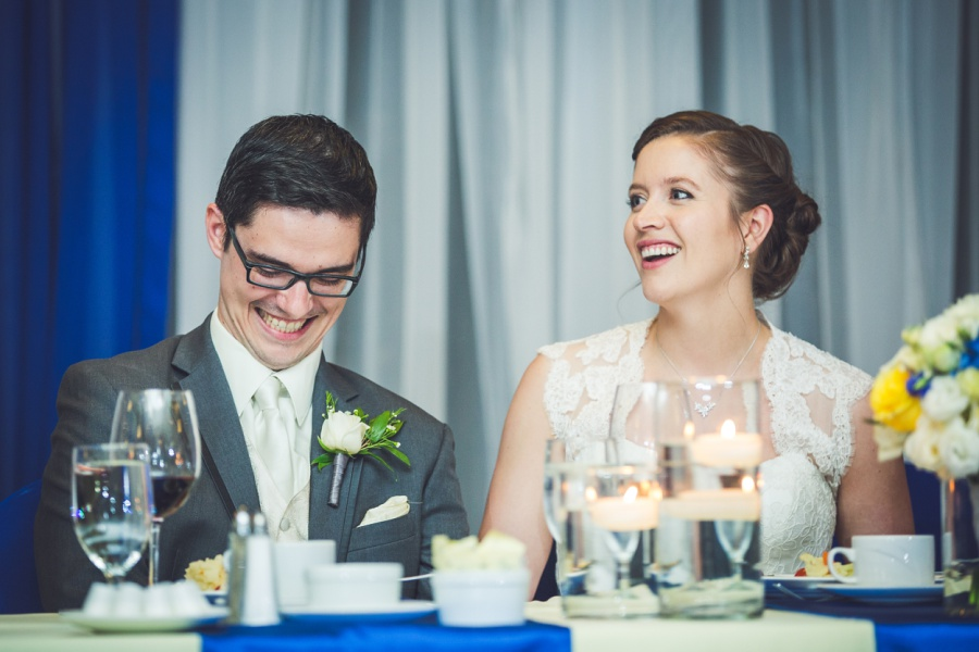 calgary latin wedding photographer carriage house inn bride groom laughing at speeches