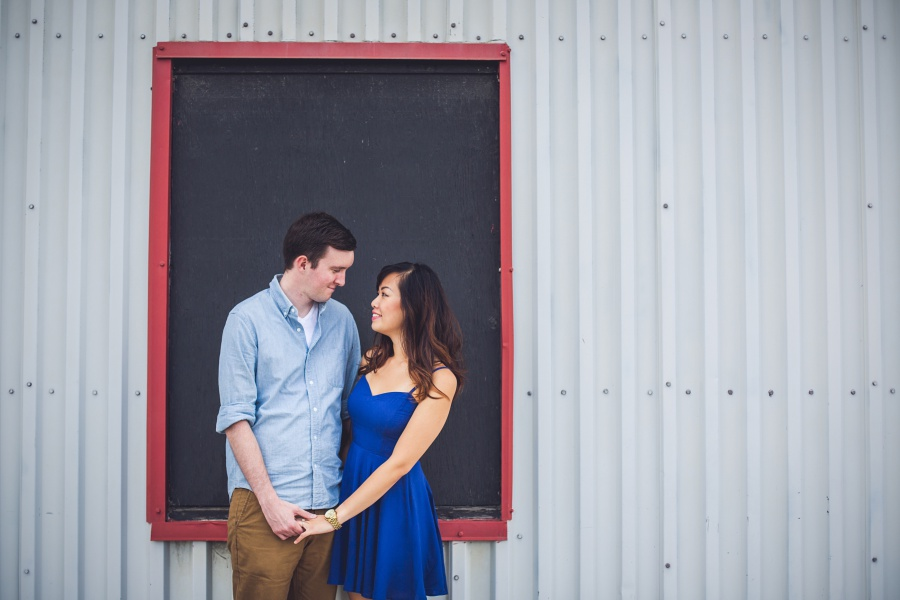 calgary ramsay engagement photos blue dress white wall red doorframe