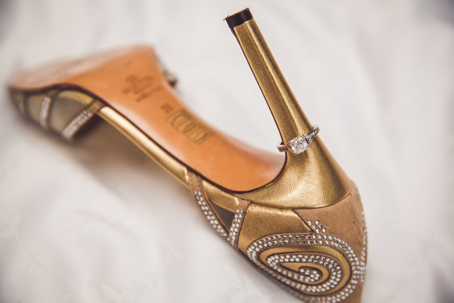 gold valentino bride shoes with engagement ring