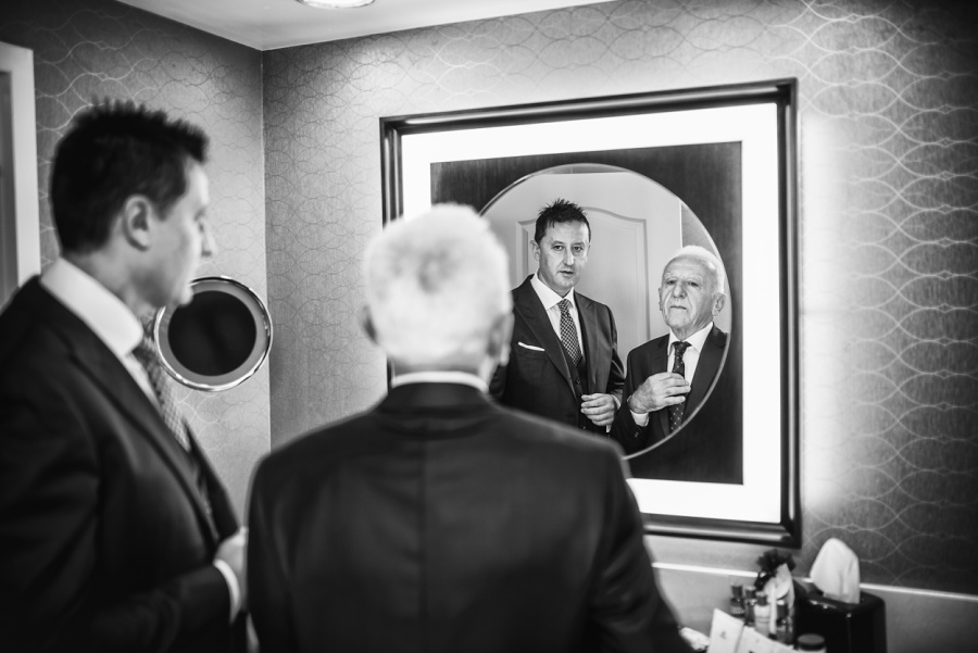 groom with father getting ready calgary wedding photographer