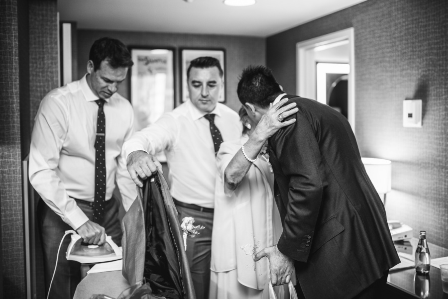 groom's mother hugs groom getting ready calgary wedding photographer