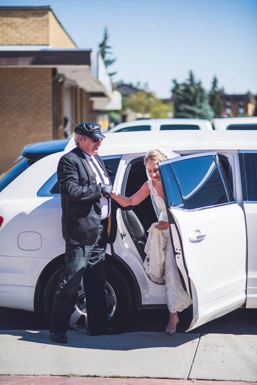 bride getting out of limo St. Demetrios Greek Orthodox Church calgary
